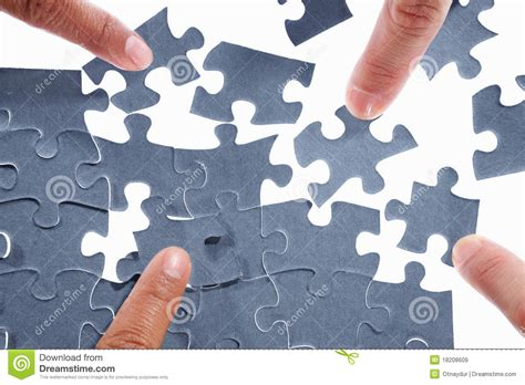 Solving The Puzzle Royalty Free Stock Images - Image: 18208609